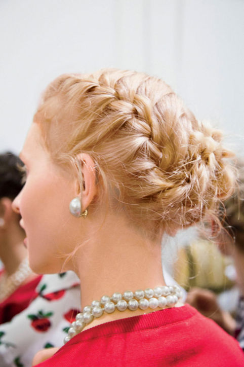 20. Braided Updos Create two French braids and twist into a low chignon. Pearls optional.