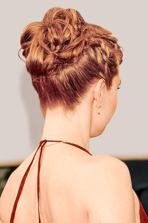 23. Braided Updos A spiraled topknot creates an elegant feel for formal events.
