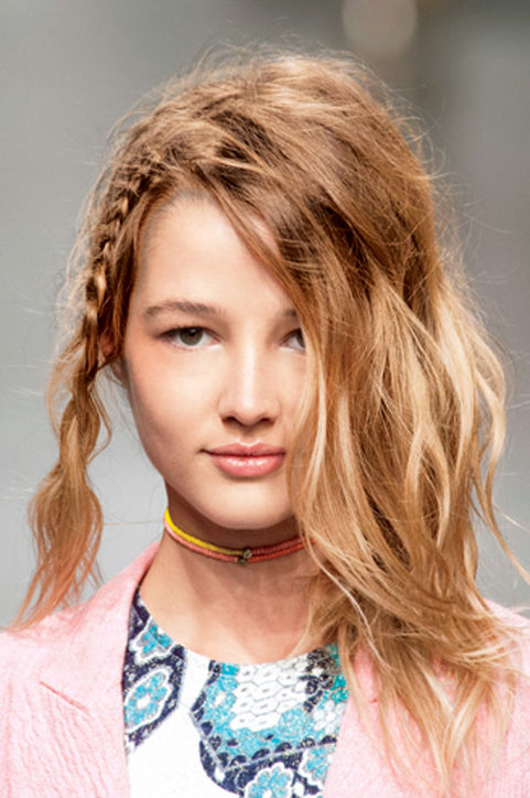 26. Tousled Braids Rock natural waves with a small side plait. So low-maintenance!
