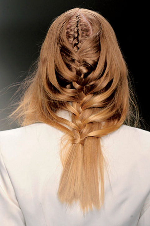 27. Tousled Braids You'll need a friend's hand for this intricate, advanced weave. Similar to this waterfall braid, right?